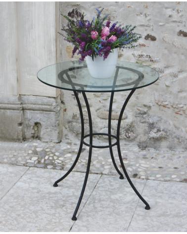 tavolino in ferro battuto rotondo con ripiano in cristallo